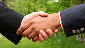 Personal Bankruptcy Attorney Shaking Hands with Client